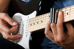 Electric guitar player performing song Royalty Free Stock Photography
