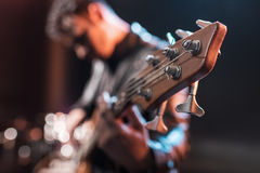 Electric guitar player playing hard rock music with bass guitar. On stage royalty free stock photos