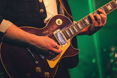 Electric guitar player on a stage, soft focus Royalty Free Stock Images