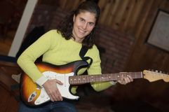 Electric Guitar player woman. Middle aged electric guitar playing woman stock image