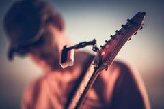 Electric Guitar Playing Closeup. Electric Guitar Playing Tuning Keys Headstock Closeup Royalty Free Stock Photo