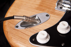 Electric guitar plugged Stock Image