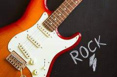 Electric guitar rock music background Stock Images