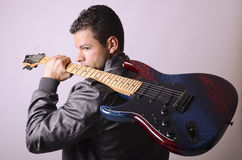 Electric guitar and rocker Royalty Free Stock Photo