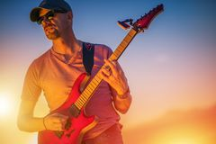 Electric Guitar Rockman. Passionate Caucasian Guitarist in His 50s Playing Rock Music royalty free stock image