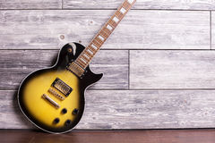 Electric guitar in room Royalty Free Stock Photography