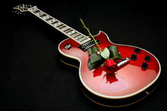 Electric Guitar with Rose Stock Photos