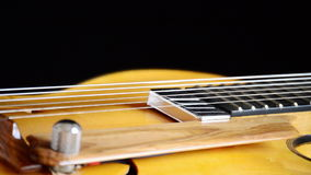 Electric Guitar Rotating, detail of pickup, strings and efes. Classic Electric Guitar Jazz Rotating in Horizontal stock video
