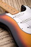 Electric guitar and sheet music royalty free stock photos