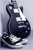 Electric guitar with shoes. Les paul electric guitar with converse shoes Royalty Free Stock Images