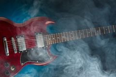 Electric guitar in smoke, closeup view Royalty Free Stock Images