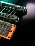 Electric guitar strings and bridge closeup stock images