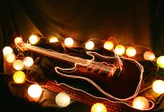 Electric guitar surrounded by lights Royalty Free Stock Photos