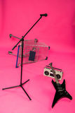 Electric guitar with tape recorder, microphone and shopping trolley Royalty Free Stock Image