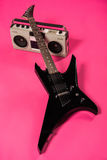 Electric guitar and tape recorder  on pink Royalty Free Stock Photos
