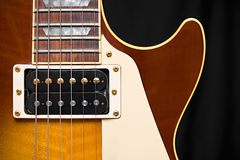 Electric Guitar with Tobacco Honey Sunburst Finish. Pickup, frets, and pick guard with room for text Royalty Free Stock Images