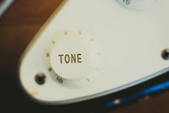 Electric guitar tone knob detail, music symbol Stock Photo