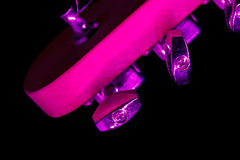 Electric guitar tuning pegs in purple light Royalty Free Stock Photos