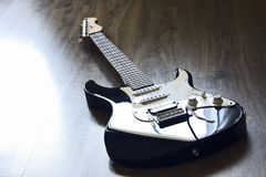 Electric guitar UCLA, lying on the floor and waiting musician Royalty Free Stock Photos