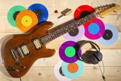 Electric guitar, 33 and 45 vinyl records, and headphones Stock Image