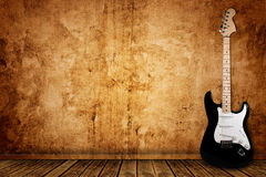 Electric guitar and the wall. Background Stock Photos