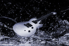 Electric guitar in water. Black and white view of electric guitar splashing in water Royalty Free Stock Photography
