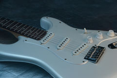 Electric guitar. White gloss finish vintage electric guitar stock photos