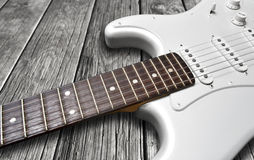 Electric guitar. White vintage electric guitar on wood surface Royalty Free Stock Photography