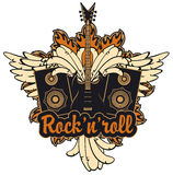 Electric guitar, wings, speakers and rock and roll. Emblem with an electric guitar, wings, speakers and inscription rock and roll Royalty Free Stock Image