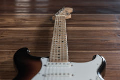 Electric guitar on wooden background. Vintage style stock photo