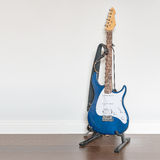 Electric guitar on wooden floor Royalty Free Stock Photos