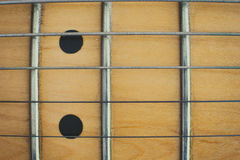 Electric guitar wooden neck and marker detail, music symbol Royalty Free Stock Photos