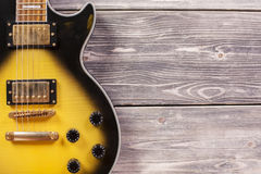 Electric guitar on wooden planks Stock Photography