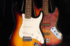 Electric guitars. On stands, dark background royalty free stock photography