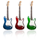 Electric guitars. Three electric guitars of different colors with reflections Stock Photography