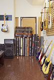 Electric guitars with guitar cases and amplifier in store Royalty Free Stock Photography