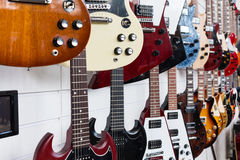 Electric guitars hanging on wall Royalty Free Stock Photo