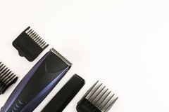 Electric hair clipper with different size attachments on a white background, top view, text space.  stock photos