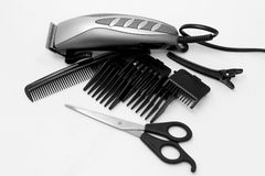 Electric hair clipper on a white background. Electric hair clipper, comb and clamp on a white background stock photo