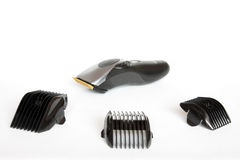 Electric Hair Clippers. With various attachments. Isolated against a white background royalty free stock photography