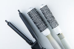 Electric hair straightener and brush roll. Stock Image