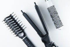 Electric hair straightener brush roll and comb. Stock Image