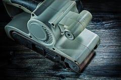 Free Electric Hand Tool Belt Detail Sander On Vintage Wood Stock Photo - 160446300