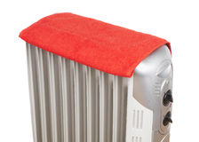 Electric heater covered by red towel Royalty Free Stock Photos