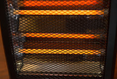 Electric heater working Stock Photography