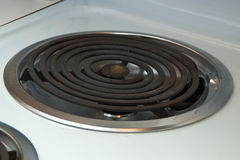 Electric heating element on stove Stock Images