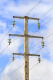 Electric high tension tower. Is a high voltage electric tower on sky background Stock Photos