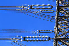 Electric high voltage pillar. Closeup of insulators. Sky background Royalty Free Stock Image