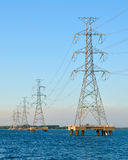Electric high voltage pole. Stand on sea stock images