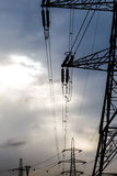 Electric high voltage polls in sunset light. Royalty Free Stock Photo